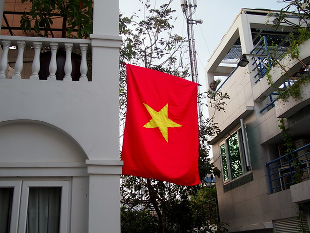 Tet in Vietnam includes almost all of the buildings hanging a Vietnamese Flag