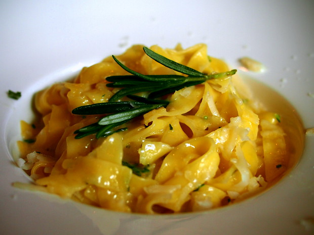 Gluten free pasta with parmesan, fresh rosemary and olive oil.