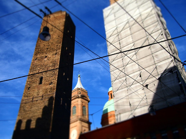 The most famous of Bologna's towers (one's clothed, however) during the day.
