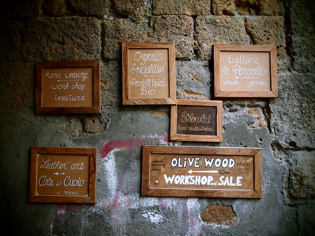 Signage for some of the smaller shops in Orvieto.