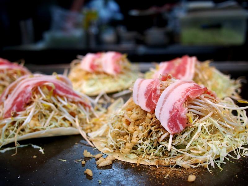 Eating Hiroshima Style okonomiyaki in Japan